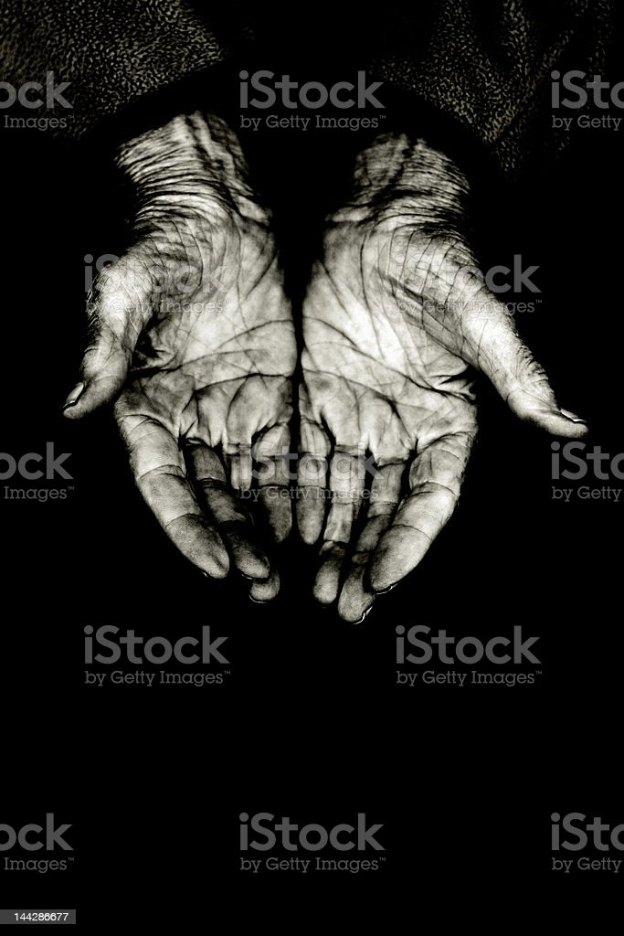 imploring hands stock photo