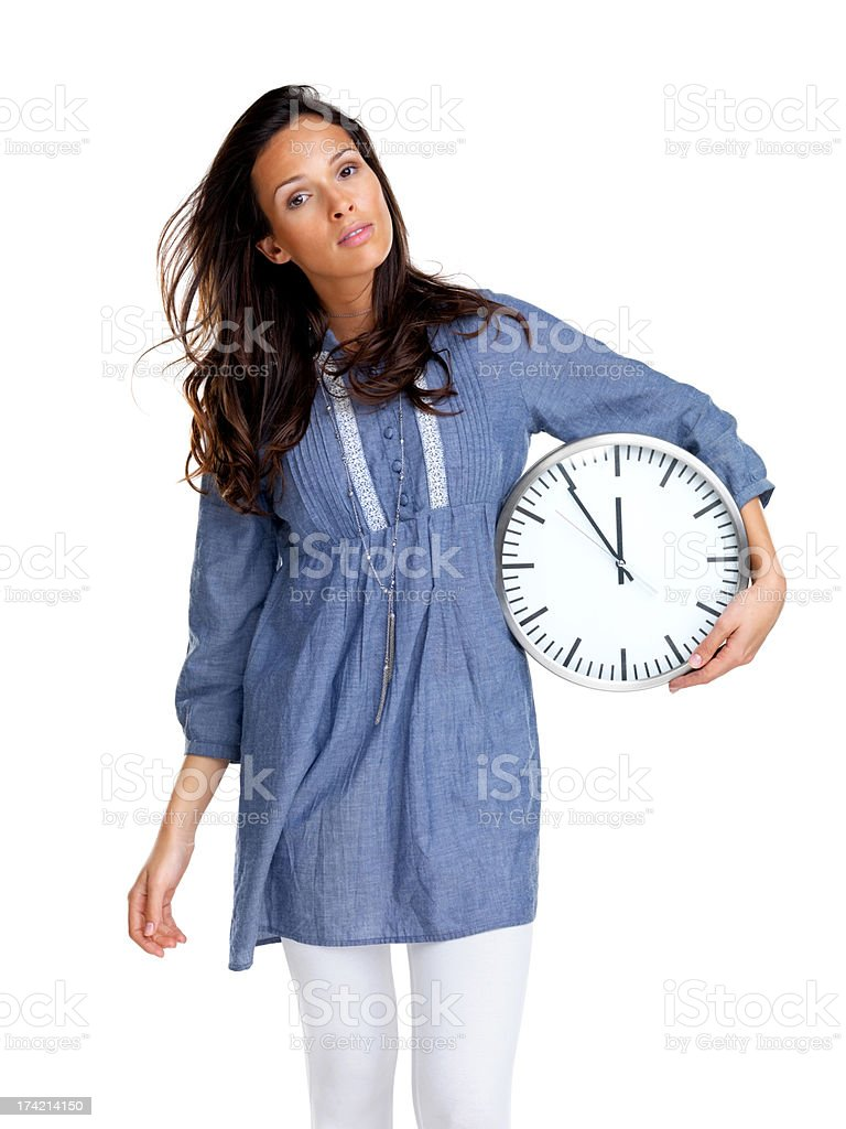 Importance of time - Pretty young girl standing with a clock stock photo