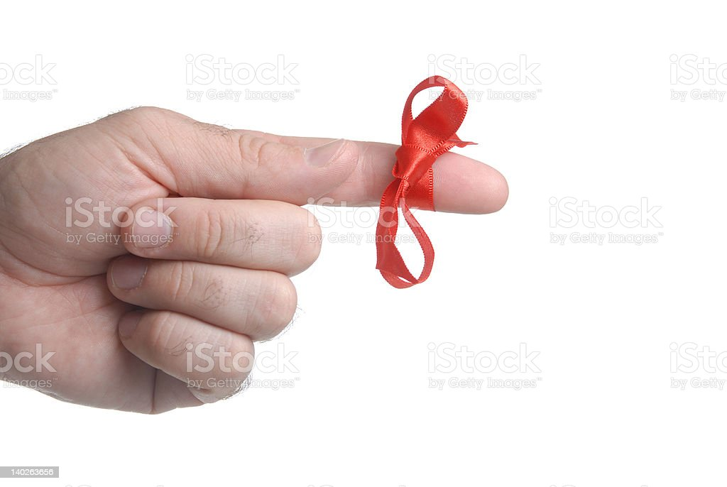 important remember ribbon tied on finger as reminder close up stock photo