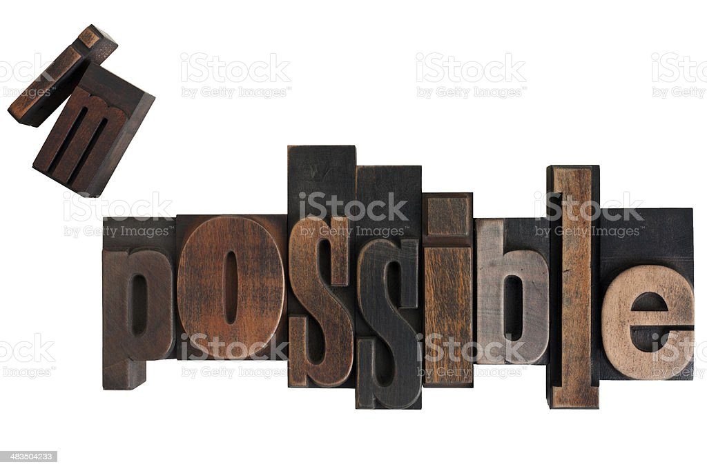 impossible to possible, vintage letterpress printing blocks stock photo