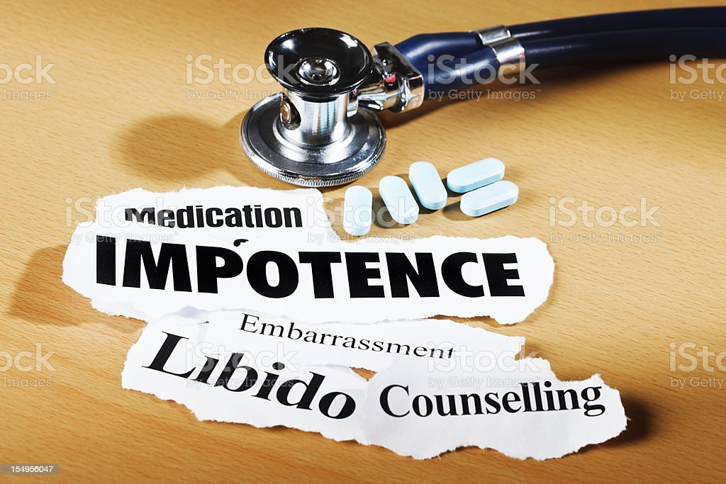 Impotence-related headlines, stethoscope and medication on doctor's desk royalty-free stock photo