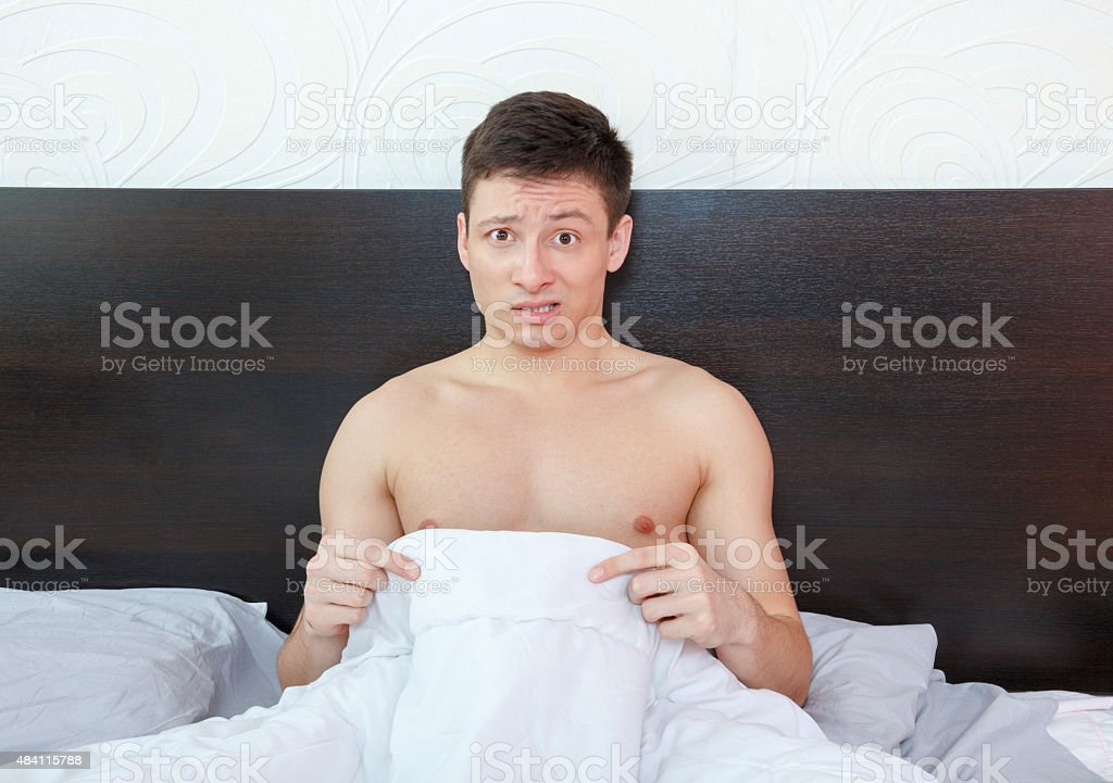 Impotent man worrying about his penis and erection failure stock photo