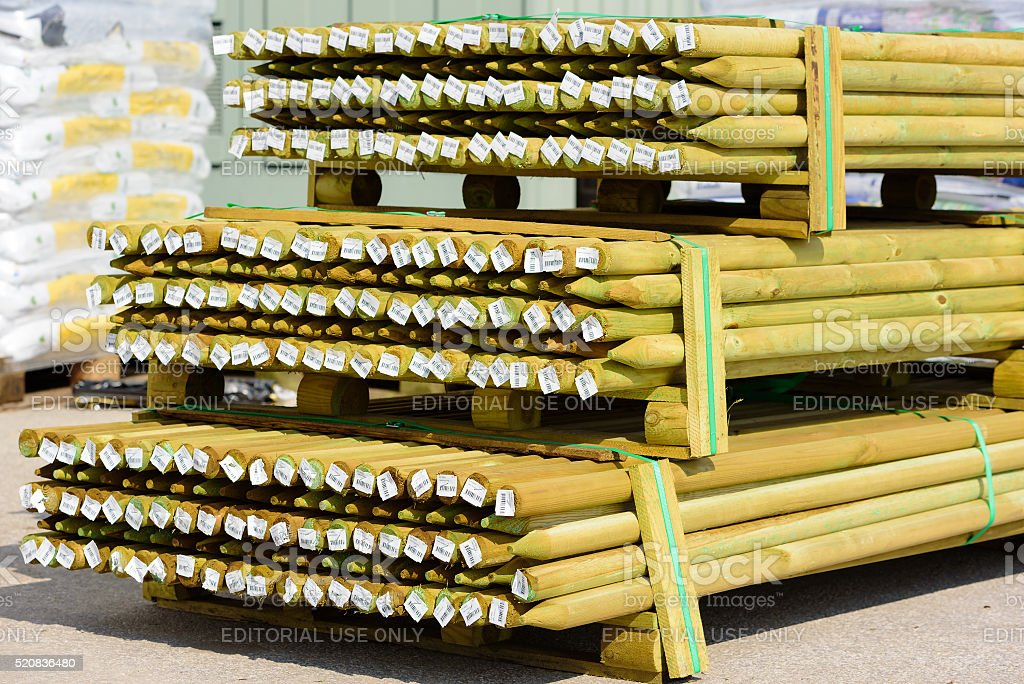 Impregnated wooden poles stock photo