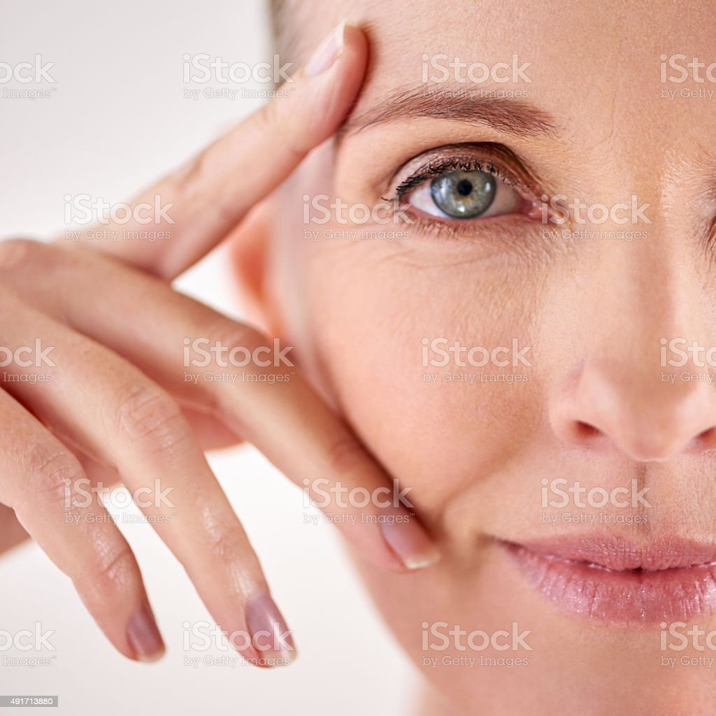 Impressed with the results of her anti-aging cream stock photo