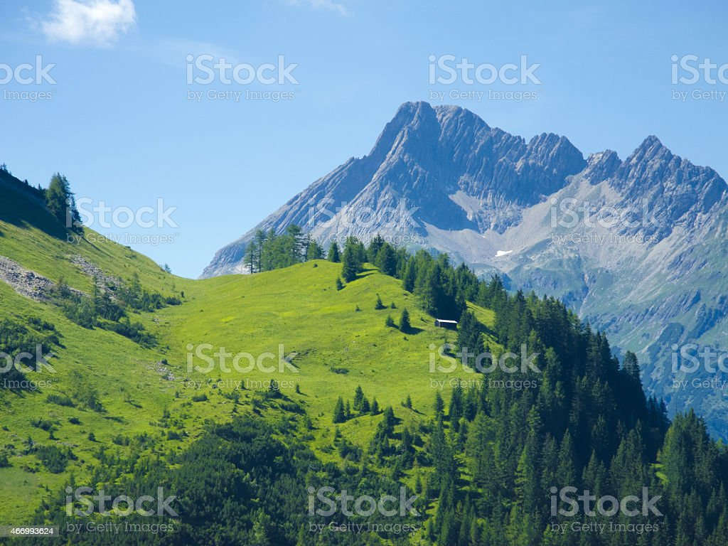 impressing mountain landscape with wooden hut stock photo