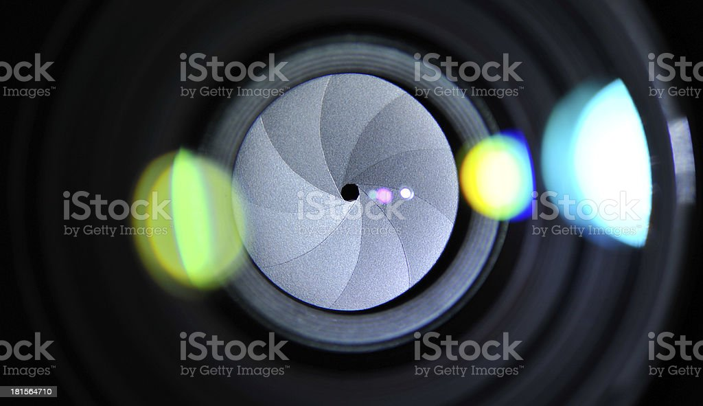 Impressions on glass elements in a camera lens stock photo