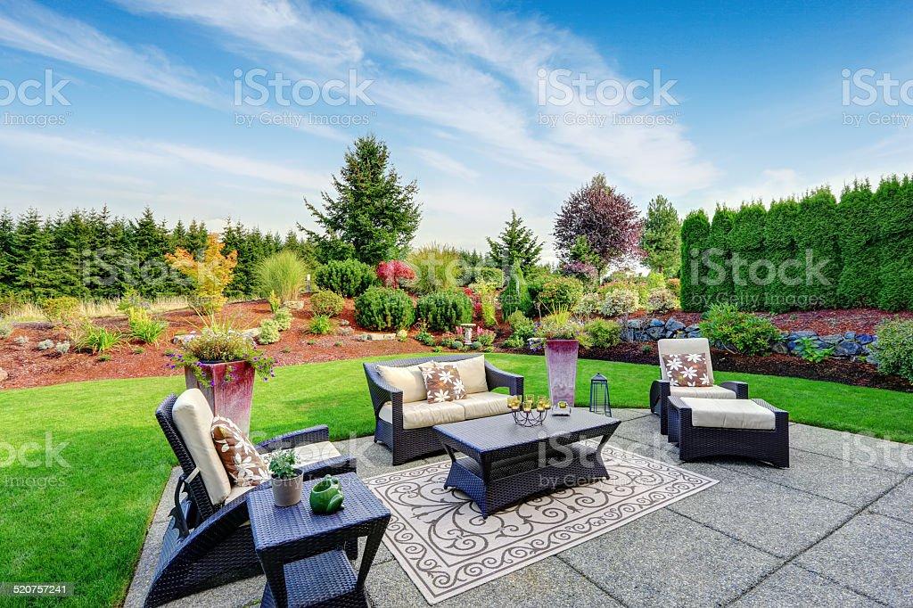Impressive backyard landscape design. Cozy patio area with settees...