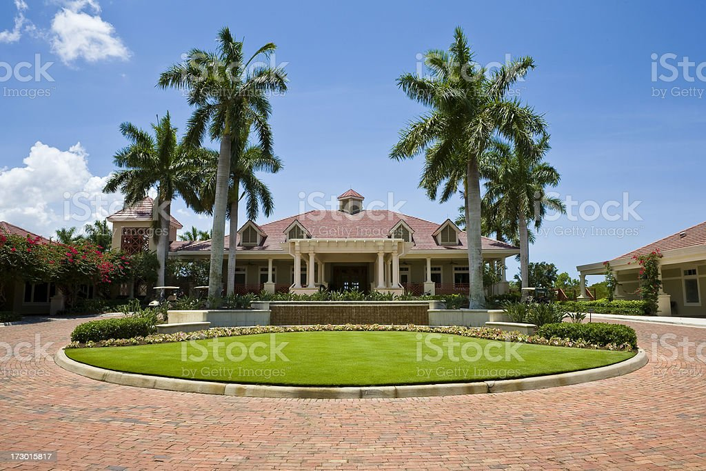 Impressive Clubhouse With Brick Driveway Florida Golf Community Wide Angle stock photo