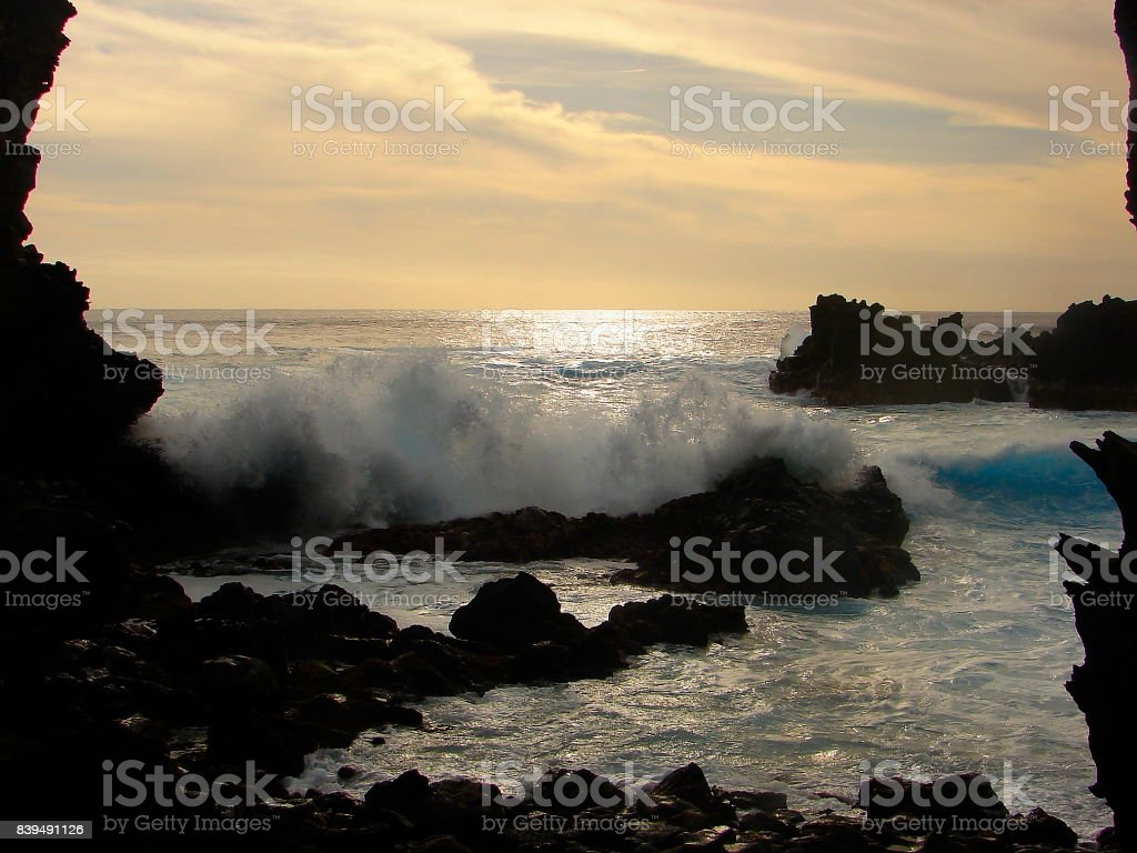 Impressive Easter Island and dramatic coastline shore: blue waves splashing on the rocks formation cliffs - Rapa Nui ancient civilization -  Idyllic pacific ocean at dramatic sunset, dramatic landscape panorama – Chile stock photo