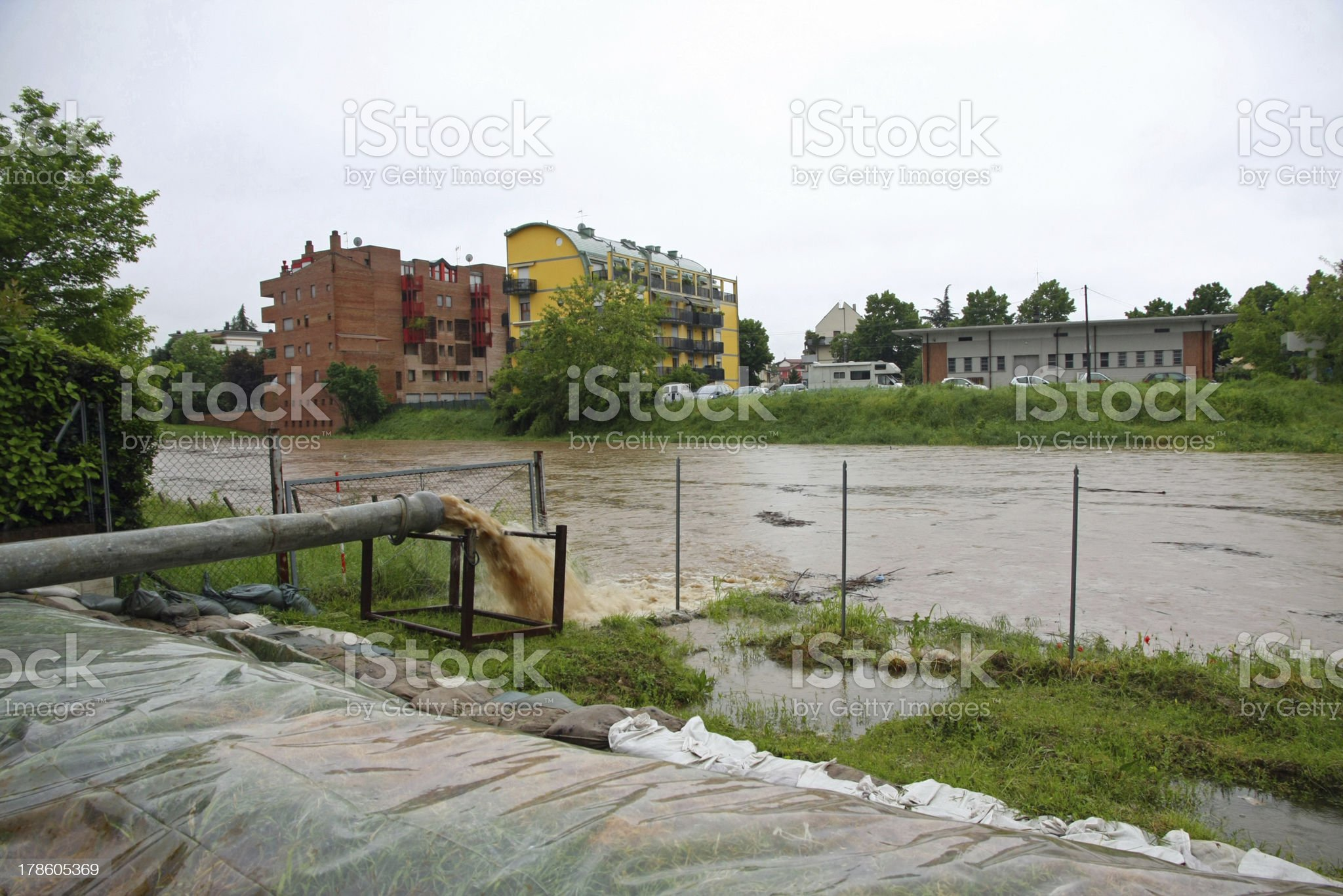 impressive exhaust flows into river rainwater and mud royalty-free stock photo
