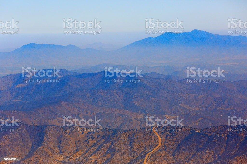 Impressive Road into Andes altiplano mountain range aerial silhouette stock photo