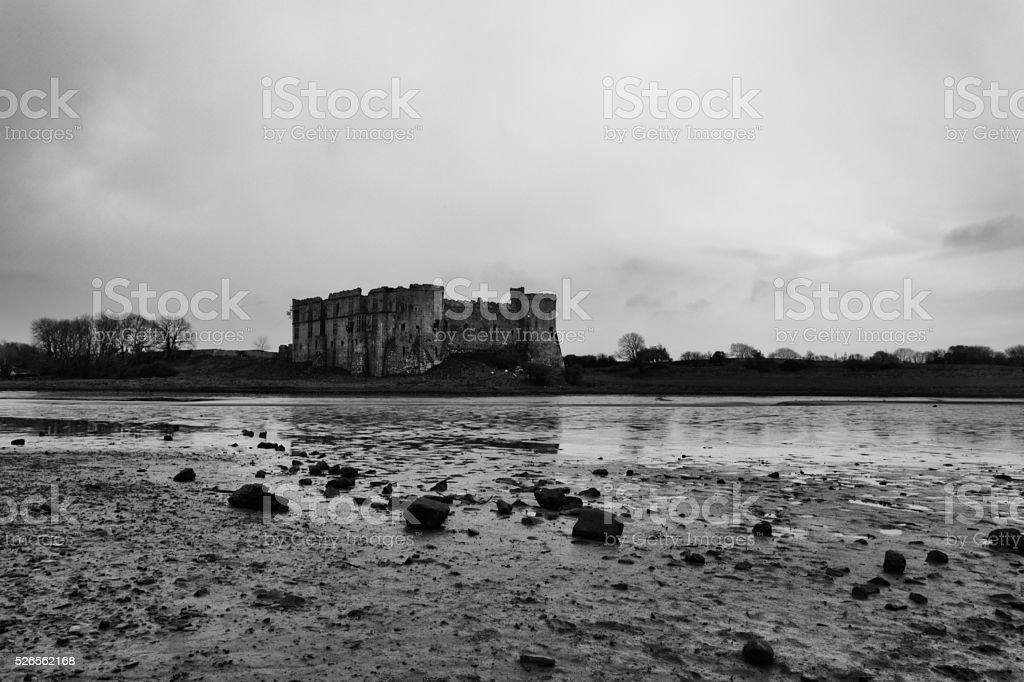Impressive stone Carew castle ruins in Pembrokeshire national coastal park stock photo
