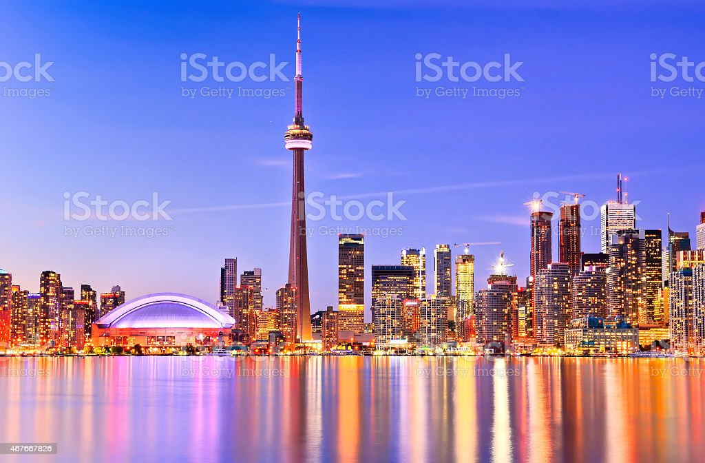 Impressive Toronto skyline reflected on water at sunset stock photo