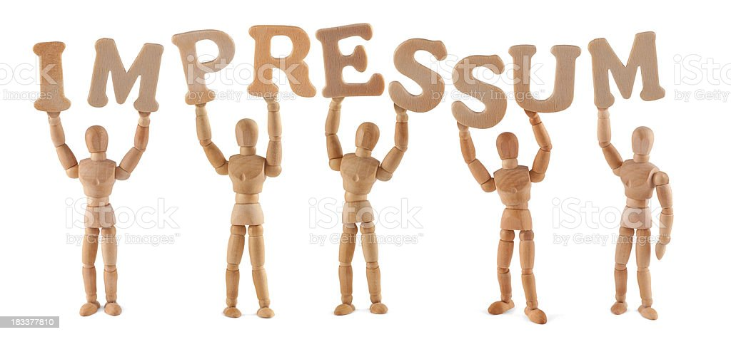 Impressum - wooden mannequin holding this word royalty-free stock photo