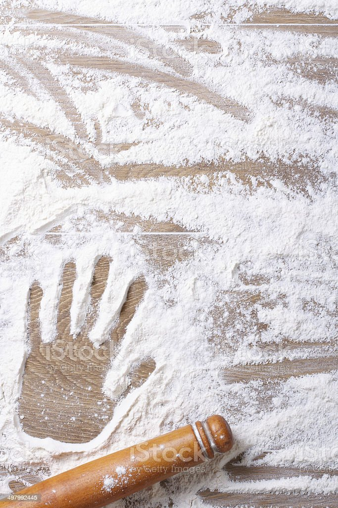 Imprint on female palm flour and rolling pin stock photo
