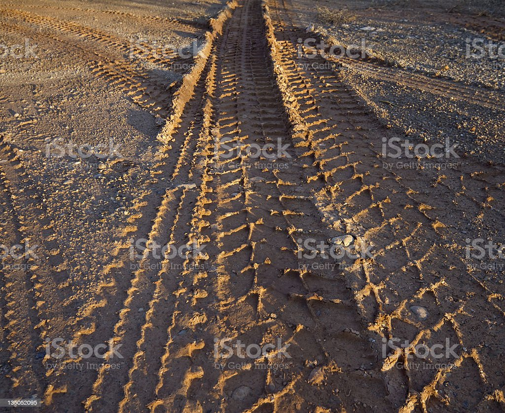 imprints of a tyre in the mud stock photo