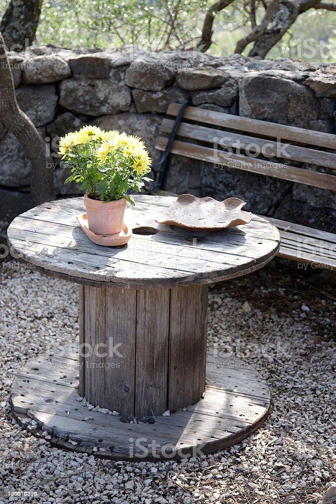 Impromptu garden furniture table stock photo
