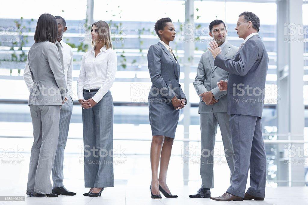 Impromptu team meeting royalty-free stock photo