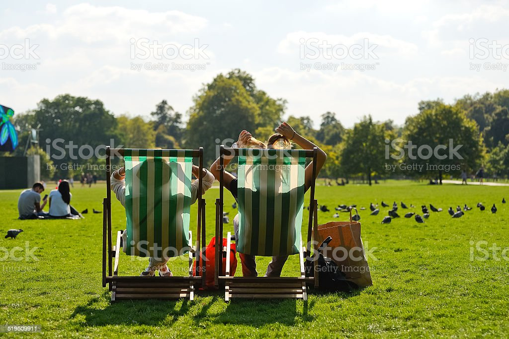In a deck chair relaxing in Hyde Park stock photo