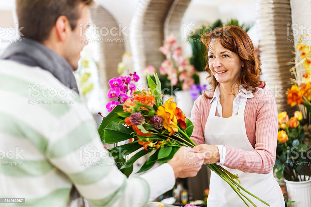 In a flower shop. stock photo