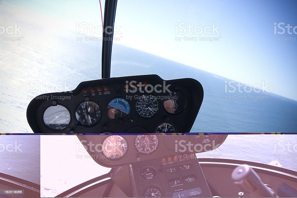 in a helicopter cockpit flying over the sea royalty-free stock photo