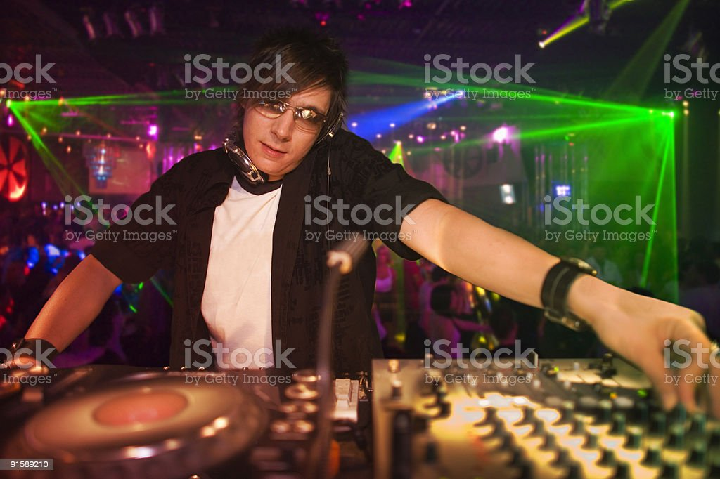 DJ in action at a nightclub stock photo