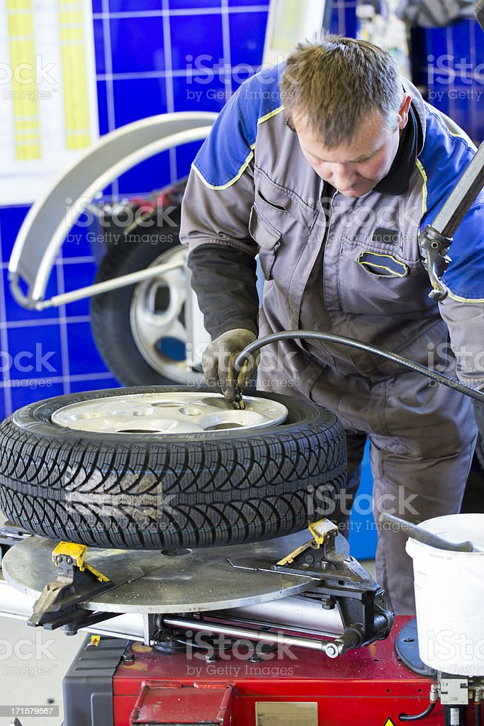 In auto repair shop...Tire air pressure test...changing tire stock photo