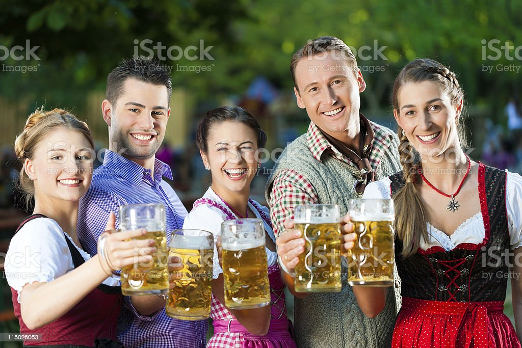 In Beer garden - friends drinking together stock photo