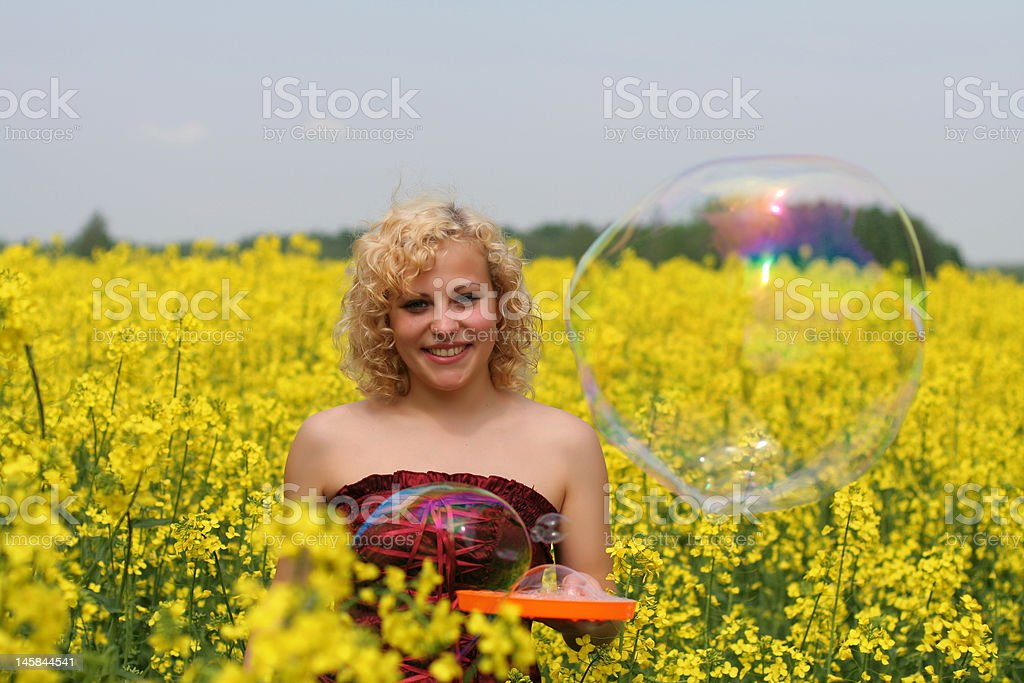In canola field royalty-free stock photo