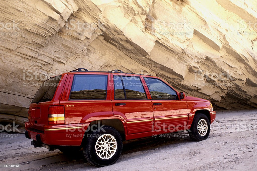 SUV in canyon stock photo