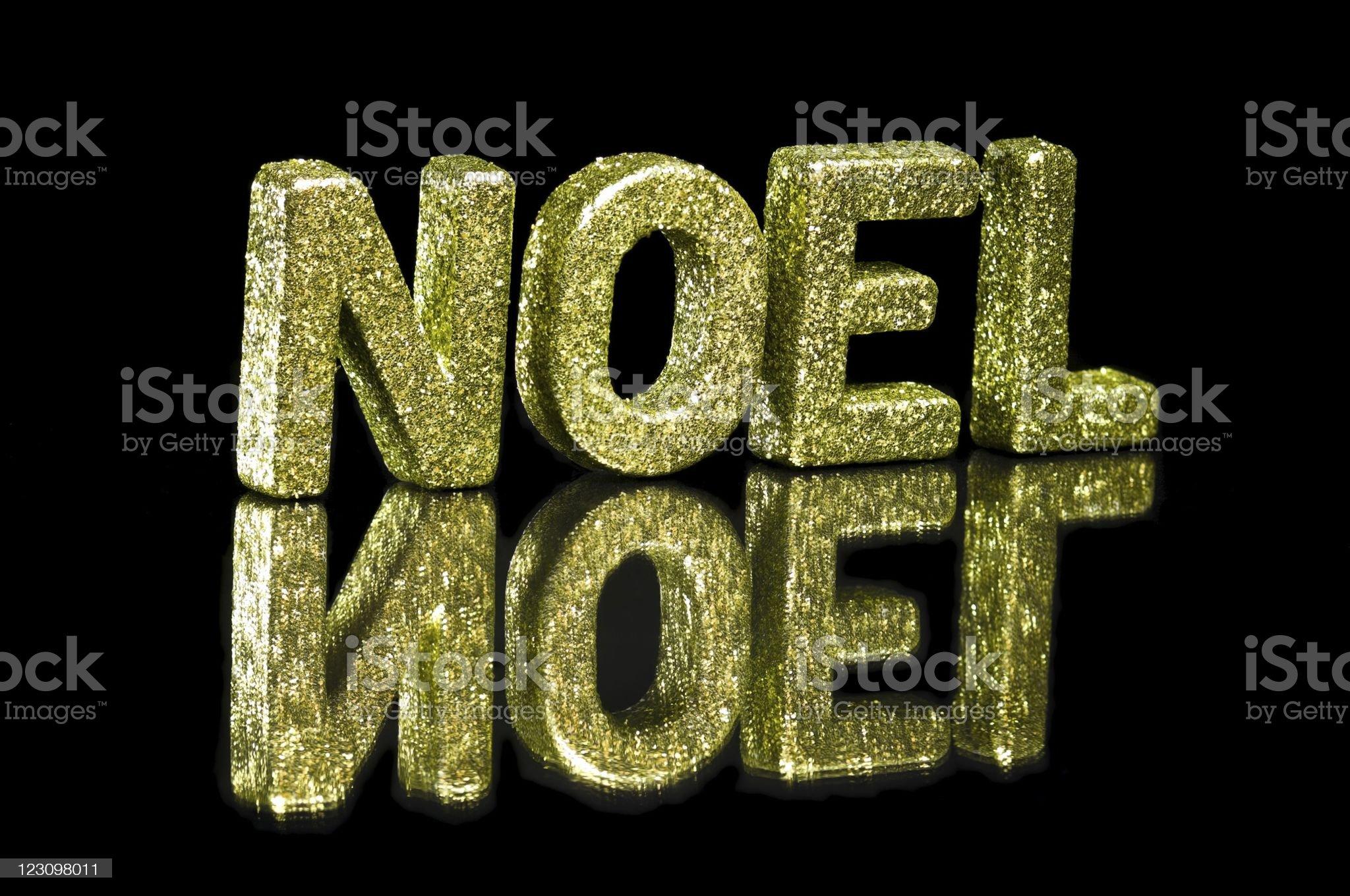 In capital letter written noel, glitter effect over black royalty-free stock photo