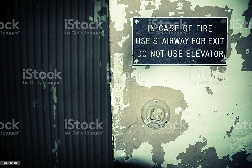 In Case of Fire Sign Next to Elevator Door royalty-free stock photo