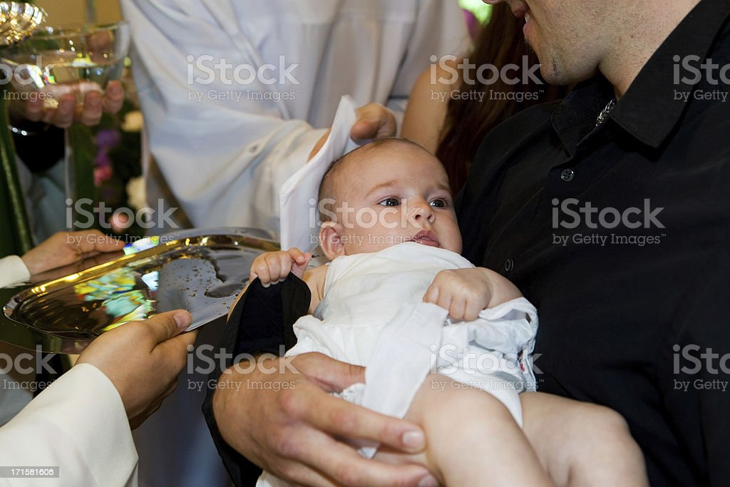 In church...Priest is baptizing little baby. royalty-free stock photo
