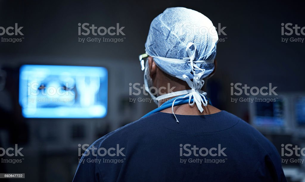 In command of his operating room stock photo