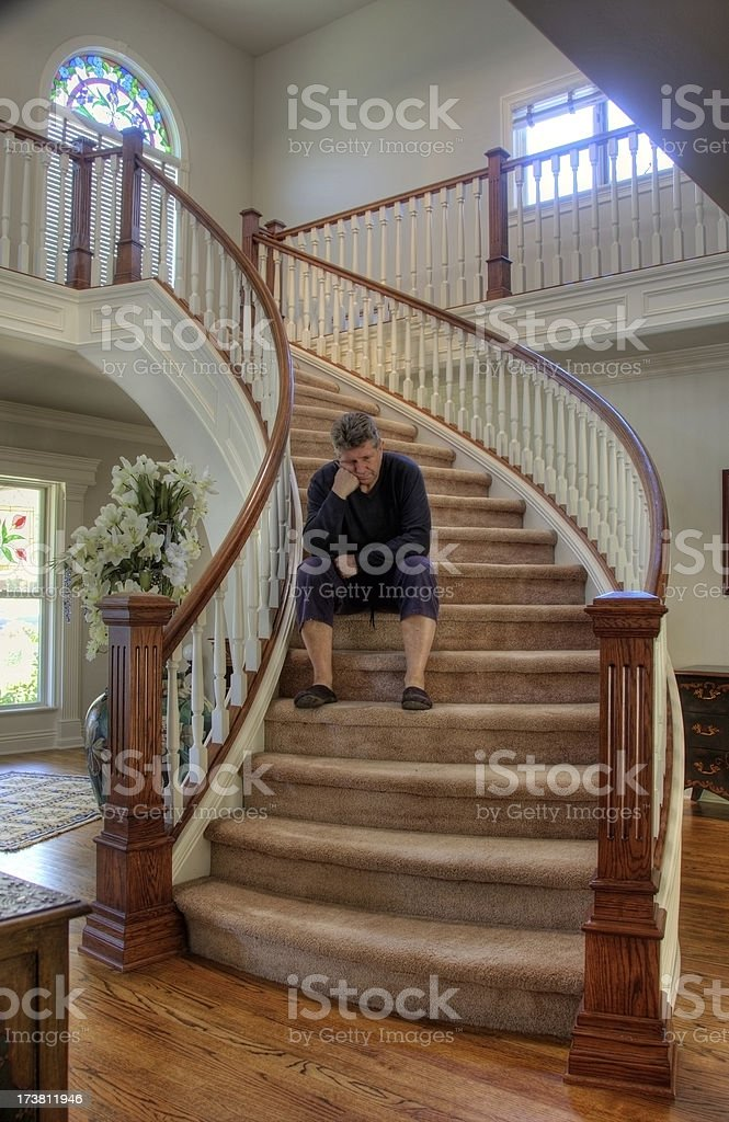 In despair on the staircase royalty-free stock photo