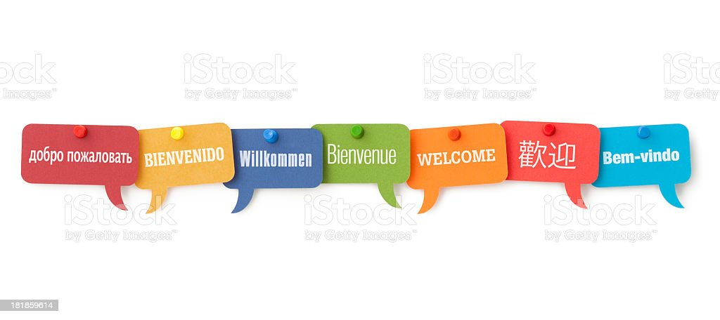 WELCOME in different languages on colourful speech bubbles royalty-free stock photo