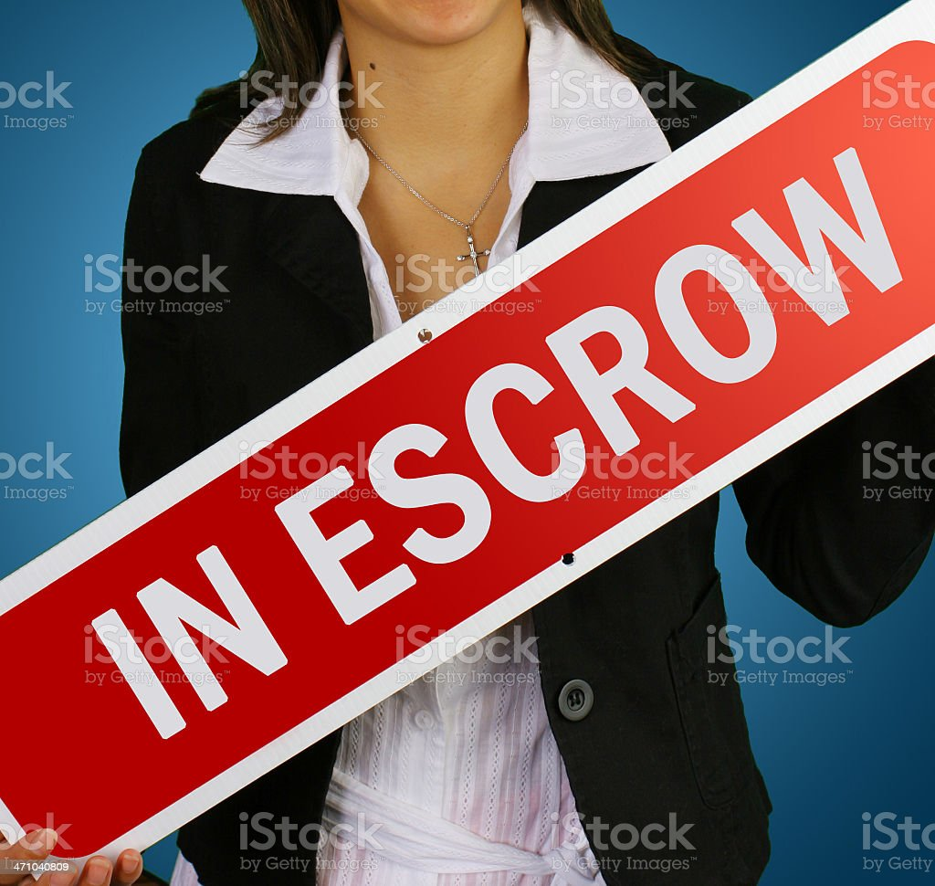 'in escrow' real estate sign royalty-free stock photo