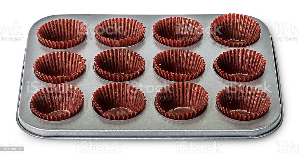 In front cupcake and muffin pan with paper cups stock photo