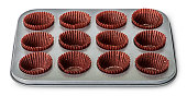 In front cupcake and muffin pan with paper cups