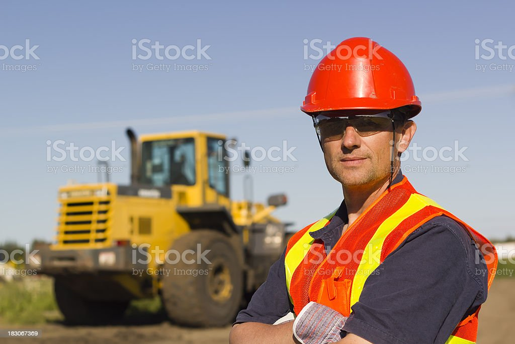 In Front of a Construction Scoop royalty-free stock photo