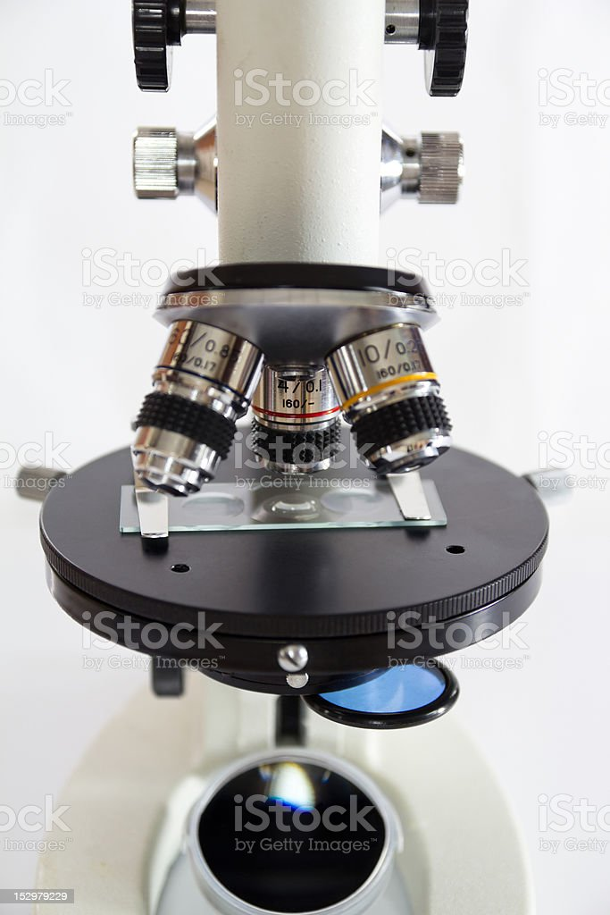 in front of microscope stock photo