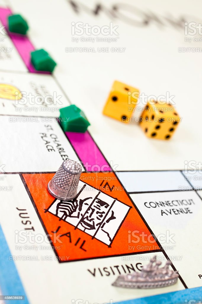 In Jail on a monopoly board with ship and thimble royalty-free stock photo