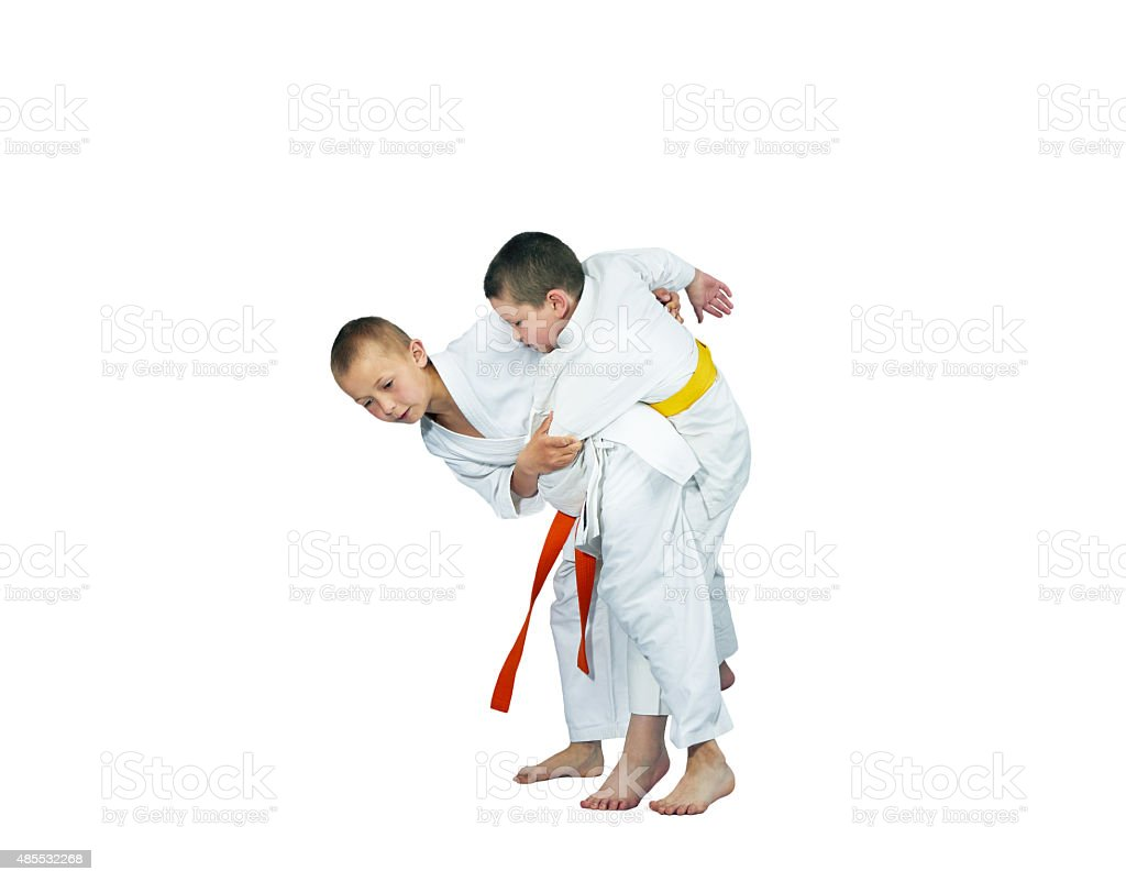 In judogi athletes are training the throws stock photo