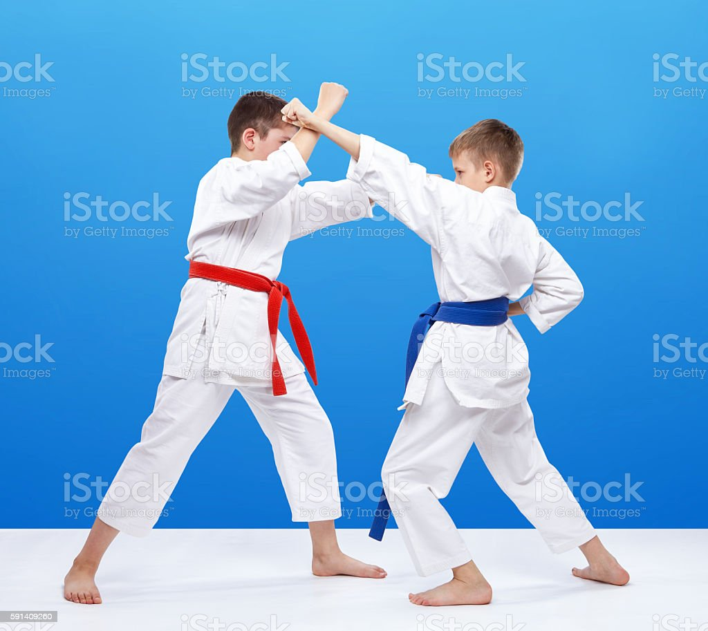 In karategi athletes are training block and blow Karate stock photo