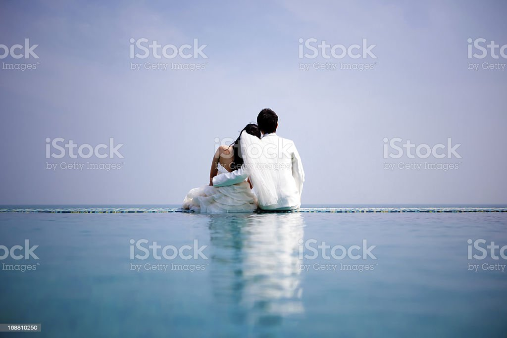 In love bride and groom near the pool royalty-free stock photo