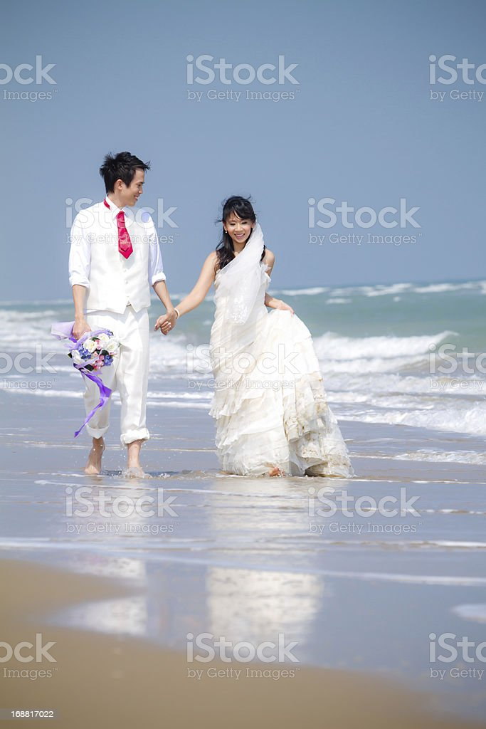 In love bride and groom on the beach royalty-free stock photo