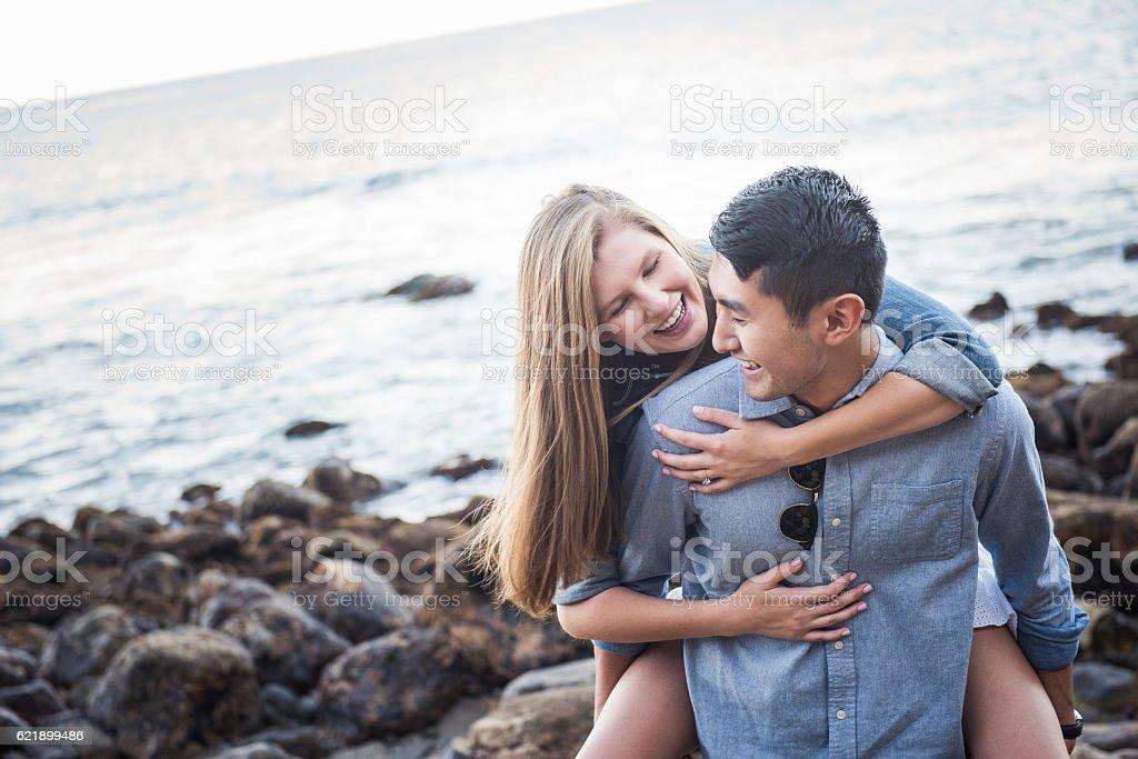 In Love Multi Racial Couple Having Fun at the Beach stock photo