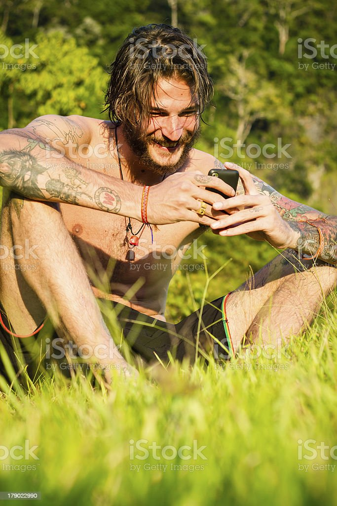 in meadow with mobile royalty-free stock photo