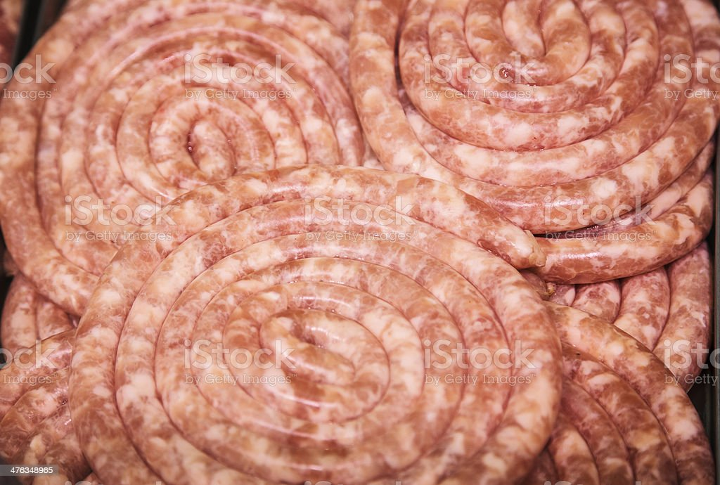 in meat tray raw pork beef sausage twisted royalty-free stock photo