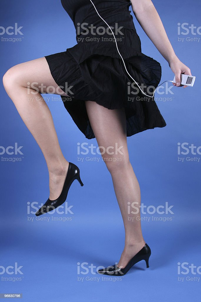 In Motion with Music on Blue stock photo